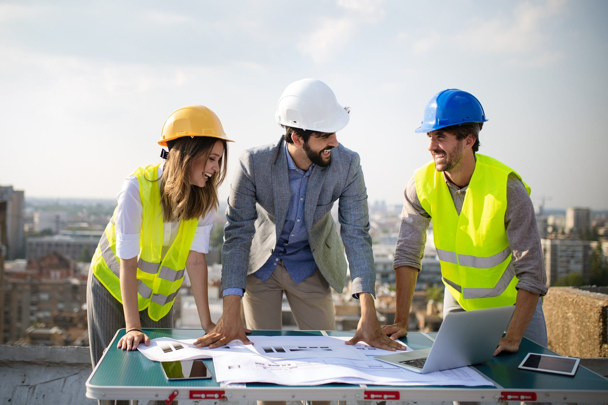Group of engineers, architects, business partners at construction site working together